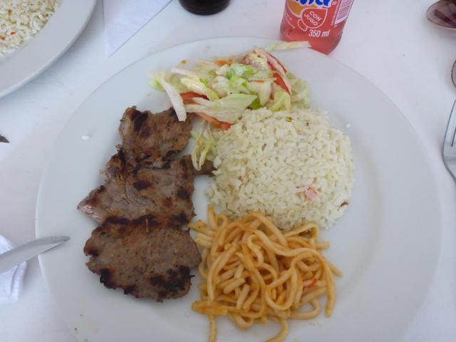 Work lunch: grilled steak, pasta, rice and salad